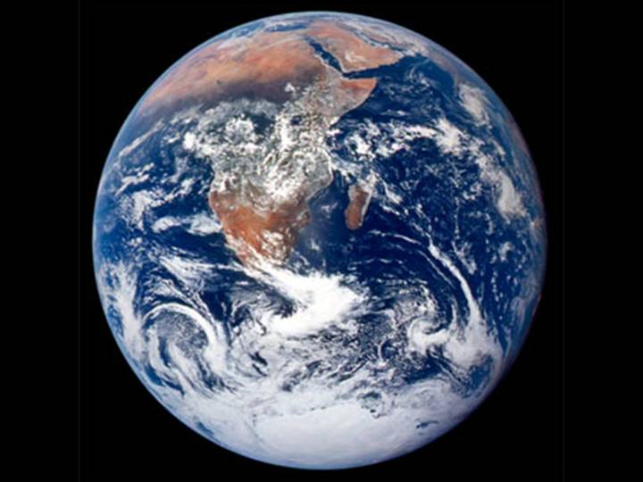 3. Earth. Image: This classic photograph was taken on December 7, 1972 by the Apollo 17 crew traveling toward the Moon. The belt of vegetation that crosses Africa below the Sahara is very dark because most of the sunlight is absorbed by plants for photosynthesis (source: NASA).